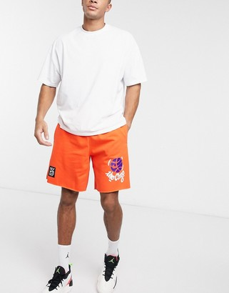 Nike Basketball West 4th fleece shorts in orange