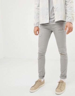 Jack and Jones Intelligence skinny fit destroyed jeans in light grey