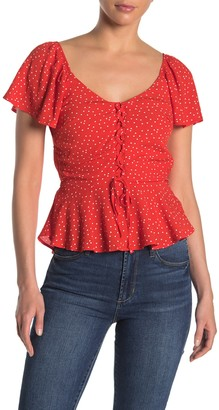 Trixxi Dot Print Lace-Up Peplum Top