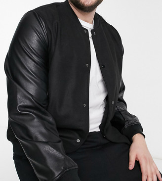 ASOS DESIGN Plus varsity jacket in black with faux leather sleeves