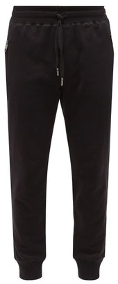 Dolce & Gabbana Logo-plaque Cuffed-ankle Cotton Track Pants - Mens - Black