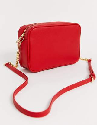 Truffle Collection red cross body bag