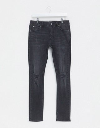 ASOS DESIGN super skinny denim jeans in washed black with rips