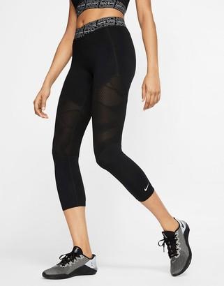 Nike Training leggings with mesh inserts in black