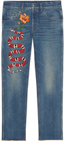 Gucci Embroidered denim pants - men - Cotton/Leather - 32
