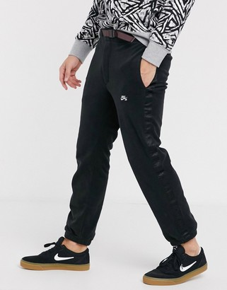 Nike Sb SB fleece joggers with nomad side stripe and clip belt in black