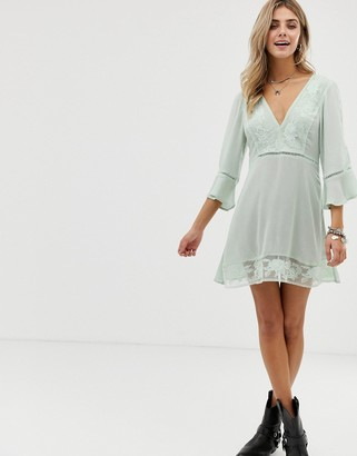 En Creme skater dress with floral lace inserts