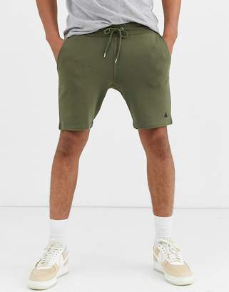 Asos Design DESIGN jersey skinny shorts in khaki with triangle-Green