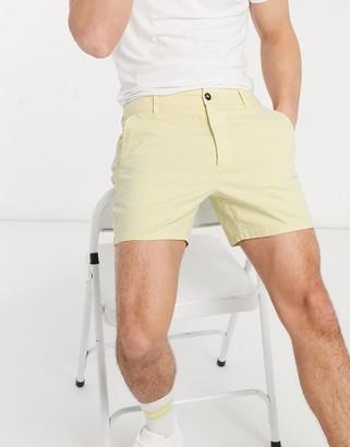 ASOS DESIGN skinny chino shorter shorts in washed yellow
