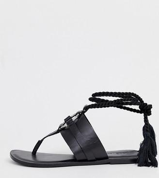 Asos DESIGN Wide Fit Vantage leather ring detail tie leg flat sandals in black