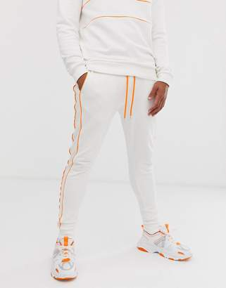 Asos Design DESIGN co-ord skinny joggers with neon piping in white