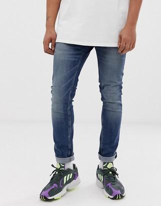 Cheap Monday tight skinny jeans in indigo head