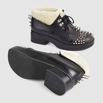 Gucci Leather bootie with spikes and studs