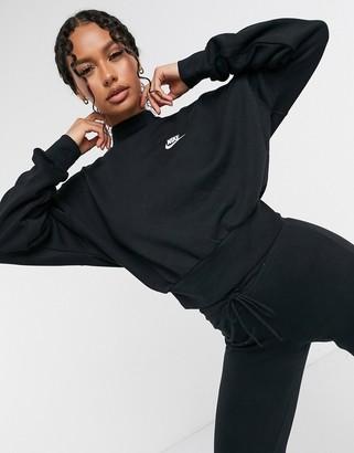 Nike essentials cropped mock neck sweatshirt in black