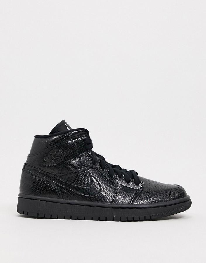 Jordan Air 1 Mid in black snakeskin