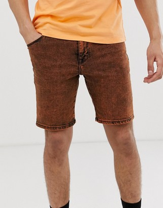 ASOS DESIGN skinny denim shorts in acid wash orange