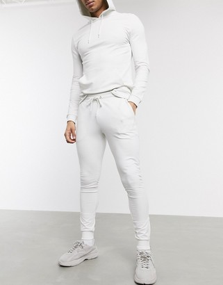 ASOS DESIGN muscle tracksuit with hoodie & silver zip sweatpants in light gray