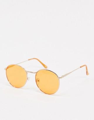 ASOS DESIGN 70s festival round sunglasses in gold metal with orange lens