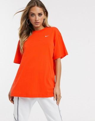 Nike orange mini swoosh oversized t-shirt