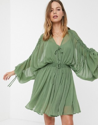 ASOS DESIGN soft tiered mini dress with drawstring waist and sleeves in khaki