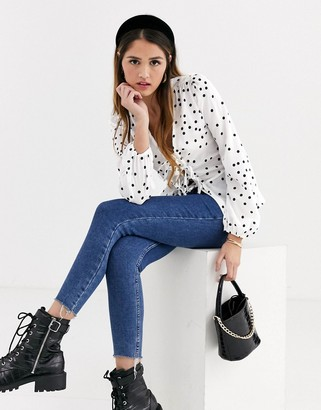 New Look peplum hem tie front top in white polka dot