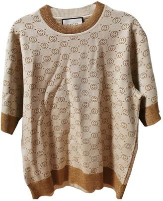 Gucci Gold Wool Knitwear for Women