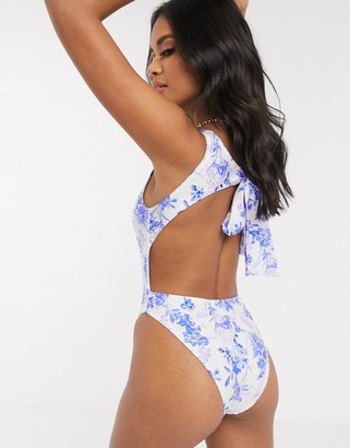 ASOS DESIGN Sleek high neck tie back swimsuit in floral print