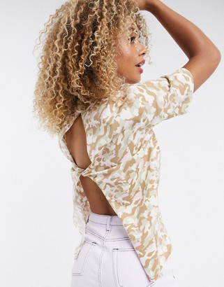 Noisy May short sleeve top with open back detail in camo