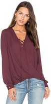 Krisa Lace Up Surplice Blouse in Purple. - size S (also in XS)