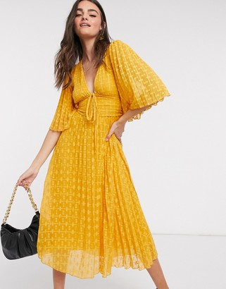 ASOS DESIGN dobby midi dress with lace up and fluted sleeves in mustard