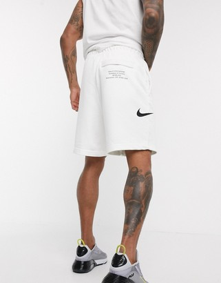 Nike Swoosh logo shorts in white