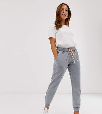 Asos DESIGN Petite jogger in acid wash with contrast stitch-Brown