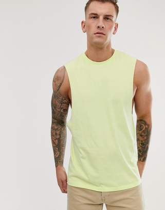 Asos Design DESIGN organic relaxed sleeveless t-shirt with dropped armhole in pale yellow-Green