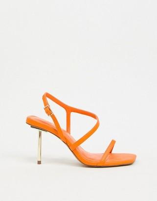 ASOS DESIGN Hook asymmetric metal heeled sandals in orange