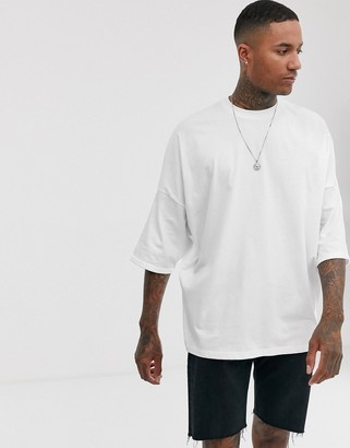 ASOS DESIGN extreme oversized longline t-shirt with roll sleeve in white