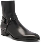 Saint Laurent Leather Wyatt Harness Boots in Black.