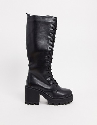Public Desire Obey lace up knee boots in black