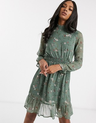 Vero Moda shift dress with high neck and ruffle hem in green floral