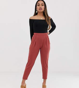 Asos DESIGN Petite ultimate jersey peg trousers-Pink