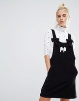 Lazy Oaf Bow Strap Eyeball Pinafore Dress In Corduroy