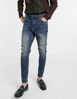 Asos DESIGN high waisted skinny jean in mid blue with greencast