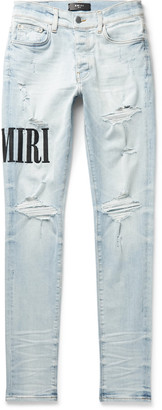 Amiri Skinny-Fit Logo-Embroidered Distressed Stretch-Denim Jeans