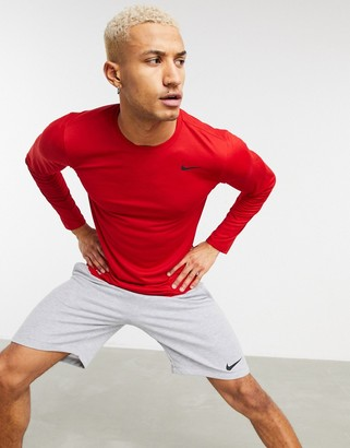 Nike Training Dri-FIT long sleeve top in red