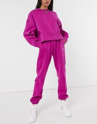 Nike mini swoosh oversized joggers in purple