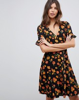 Asos DESIGN button through tea dress with frill sleeve in floral print