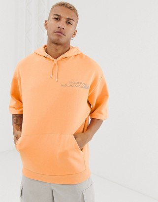 Asos Design DESIGN short sleeve oversized hoodie in pale orange with reflective print