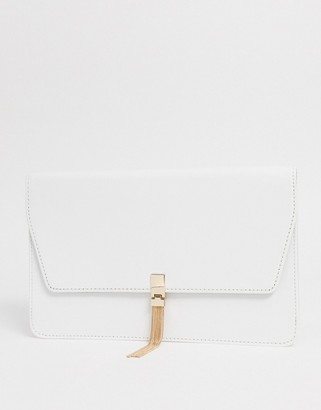 ASOS DESIGN clutch with tab & tassel in white