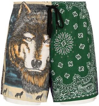 Children of the Discordance Bandana-pattern asymmetric track shorts