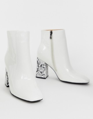 Public Desire Vesper white ankle boots with square toe and snake heel