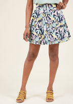 3492 Lift your spirits while scoring major style points in this navy circle skirt! A print of fresh fruit, lush foliage, and wild animals delights on this cotton garment, which brings a touch of whimsy to your everyday look. Worn with your winning smile, this
